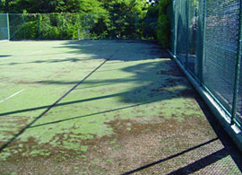 tennis court before resurfacing/maintenance